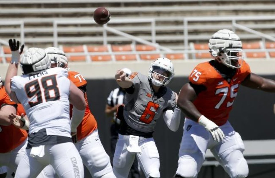 Photo -  Oklahoma State quarterback Dru Brown (6) throws the ball during Saturday's scrimmage in Stillwater. The former Hawaii starter is competing with redshirt freshman Spencer Sanders for the Cowboys' starting job next season. [Sarah Phipps/The Oklahoman]