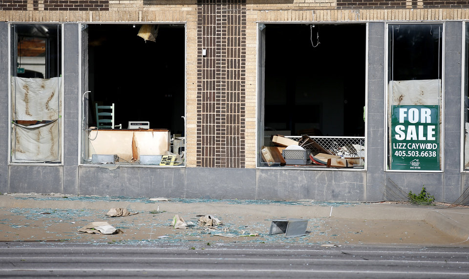 Photo - Damage at the former Rainbow music store is pictured at NW 23rd and Classen after an apparent tornado moved through the area in Oklahoma City, Sunday, May 26, 2019.  [Sarah Phipps/The Oklahoman]