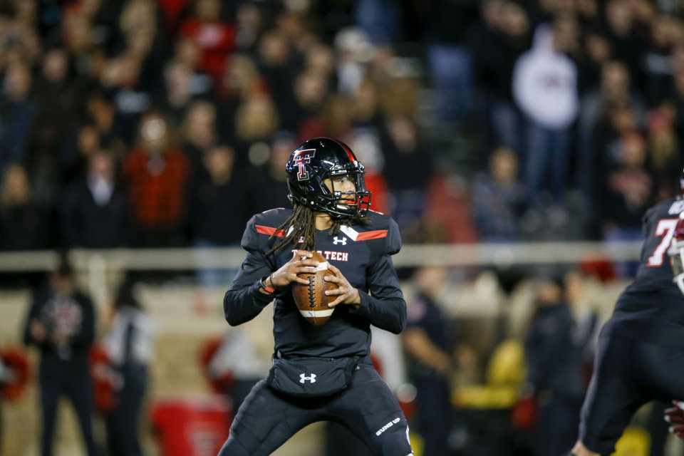 Photo - Texas Tech Red Raiders quarterback Jett Duffey (7) attempts a  pass during the NCAA football game between the Texas Tech Red Raiders and the Oklahoma Sooners at Jones AT&T Stadium in Lubbock, Texas on Saturday, November 03, 2018. IAN MAULE/Tulsa World