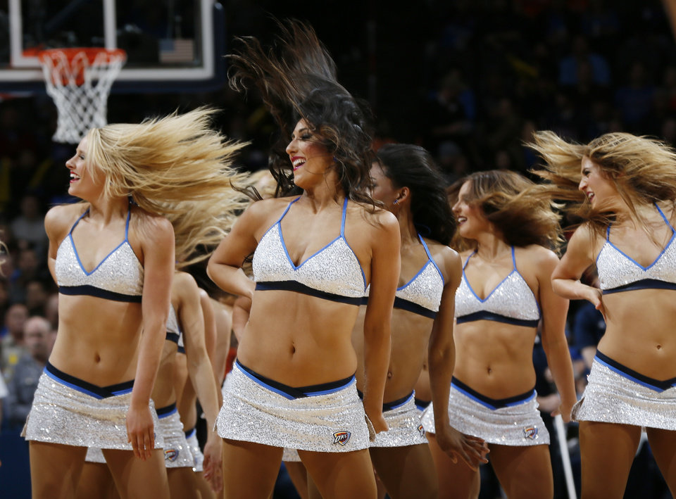 Photo - The Thunder Girls dance team performs during an NBA basketball game between the New Orleans Pelicans and the Oklahoma City Thunder at Chesapeake Energy Arena in Oklahoma City, Thursday, Feb. 11, 2016.  Photo by Nate Billings, The Oklahoman