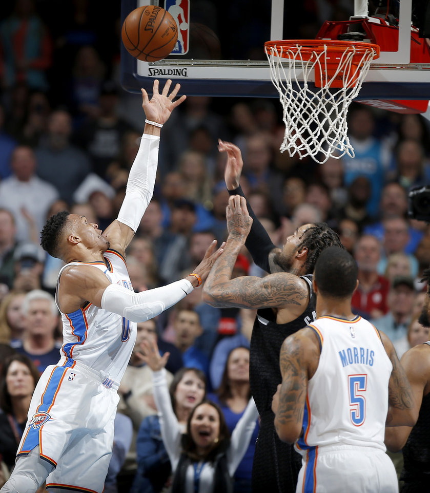 Photo - Oklahoma City's Russell Westbrook (0) shoots the ball beside Sacramento's Willie Cauley-Stein (00) during an NBA basketball game between the Oklahoma City Thunder and the Sacramento Kings at Chesapeake Energy Arena in Oklahoma City, Saturday, Feb. 23, 2019. Sacramento won 119-116. Photo by Bryan Terry, The Oklahoman