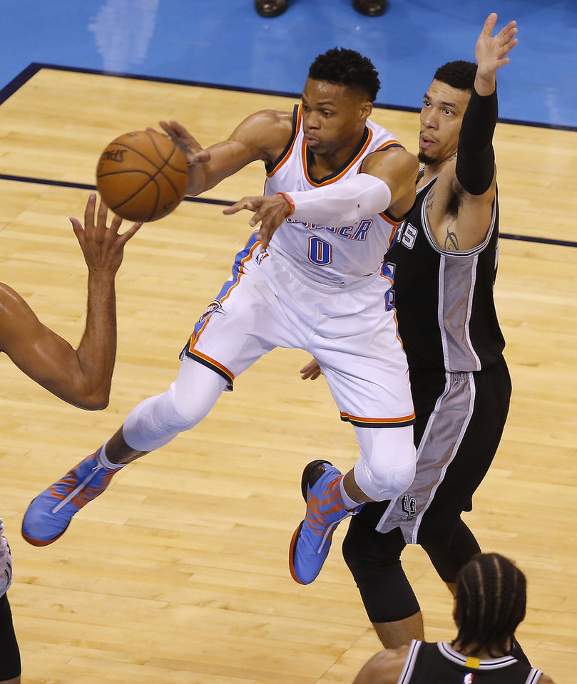 Photo - Oklahoma City's Russell Westbrook (0) passes the ball as San Antonio's Danny Green (14) defends during Game 4 of the Western Conference semifinals between the Oklahoma City Thunder and the San Antonio Spurs in the NBA playoffs at Chesapeake Energy Arena in Oklahoma City, Sunday, May 8, 2016. Photo by Sarah Phipps, The Oklahoman