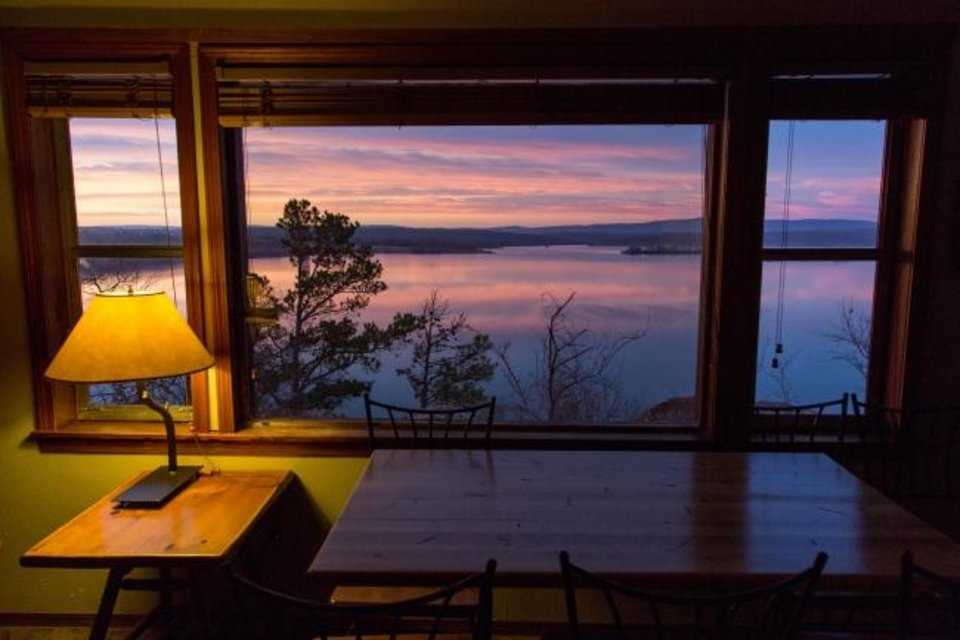 Photo -  Watch the sunset across the lake through the window of a cabin at Lake Wister State Park. [Lori Duckworth/Oklahoma Tourism and Recreation Department]