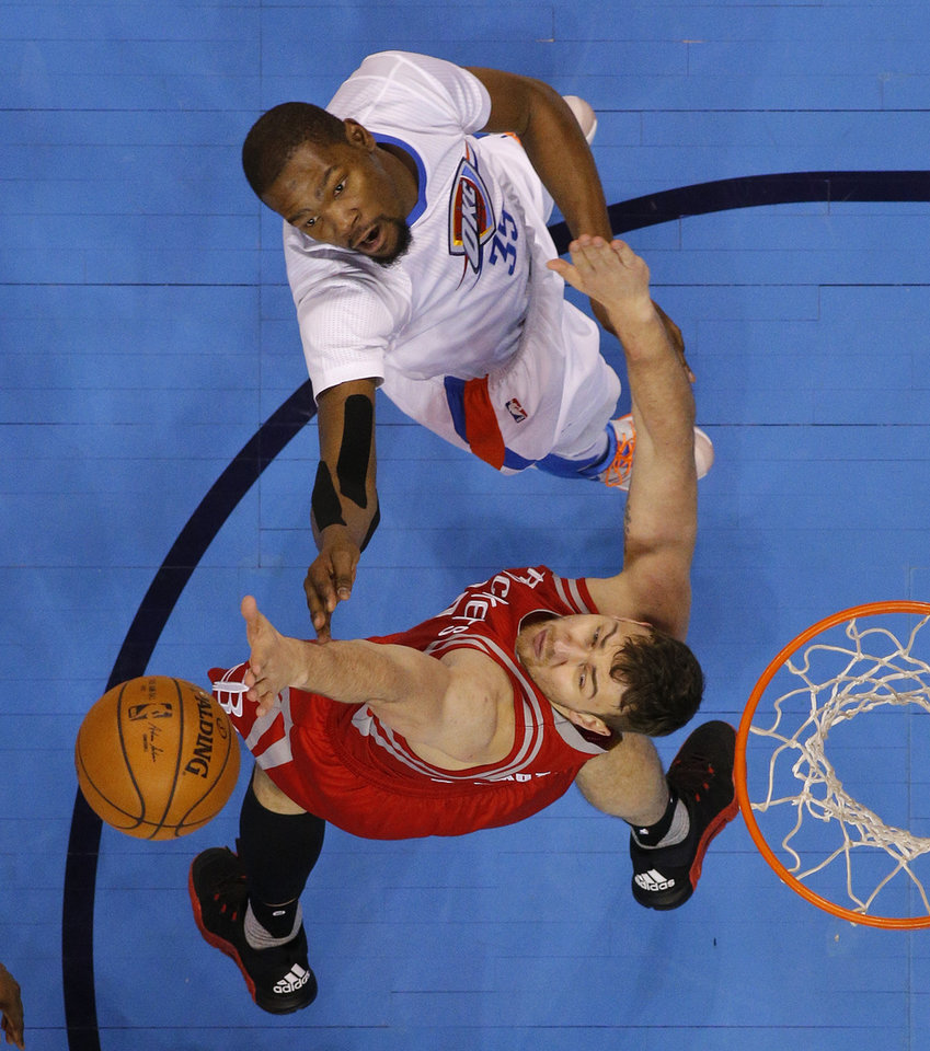 Photo - Oklahoma City's Kevin Durant (35) shoots over Houston's Donatas Motiejunas (20) during an NBA basketball game between the Oklahoma City Thunder and the Houston Rockets at Chesapeake Energy Arena in Oklahoma City, Tuesday, March 22, 2016. Photo by Bryan Terry, The Oklahoman