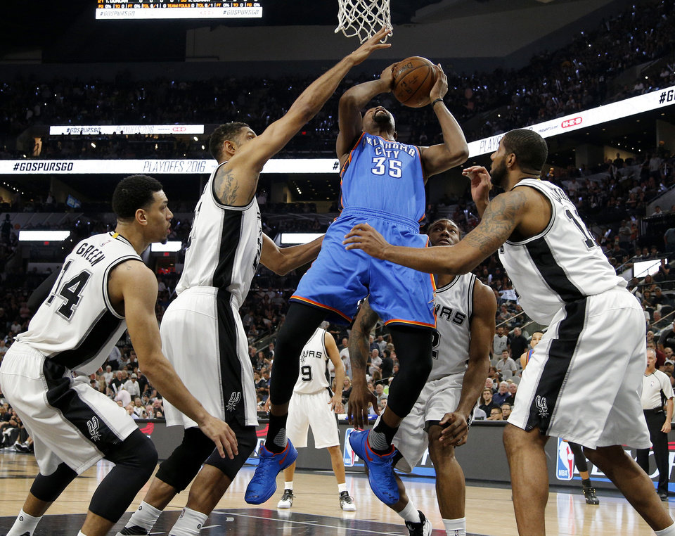 Photo - Oklahoma City's Kevin Durant (35) goes up for a basket between San Antonio's Danny Green (14), Tim Duncan (21), Kawhi Leonard (2) and LaMarcus Aldridge (12) during Game 5 of the second-round series between the Oklahoma City Thunder and the San Antonio Spurs in the NBA playoffs at the AT&T Center in San Antonio, Tuesday, May 10, 2016. Oklahoma City won 95-91. Photo by Bryan Terry, The Oklahoman