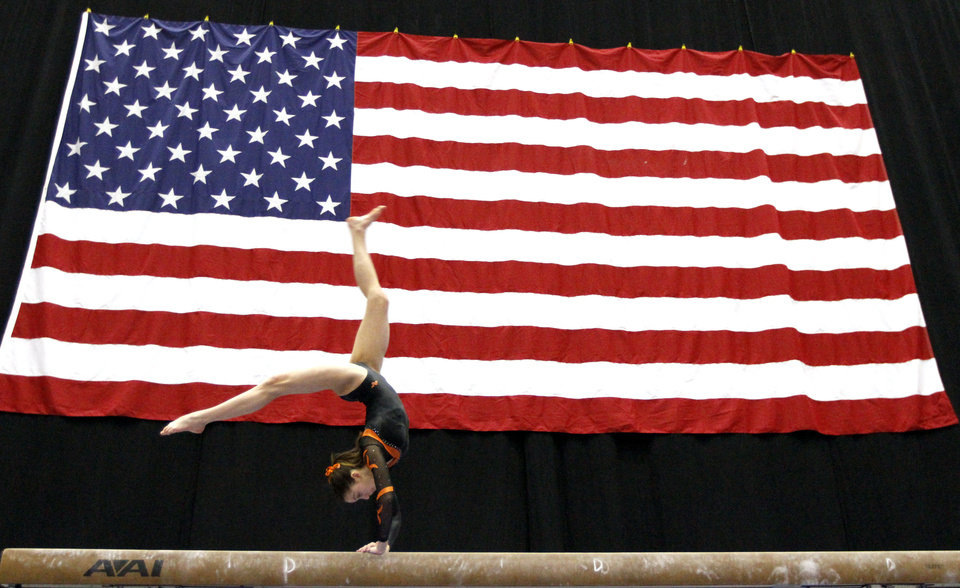 Photo -  Rebekah Nelson with Elite Gymnastics Academy competes in the balance beam during the Nadia Comaneci International Invitational as part of the Bart and Nadia Sports and Health Festival, at the Cox Convention Center in Oklahoma City, Sunday, Feb. 12, 2012. Photo by Sarah Phipps, The Oklahoman