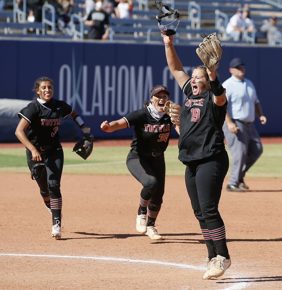 Photo - Tuttle's Cami Cobb, right, celebrates after wining the Class 4A state softball championship game between Tuttle and Lone Grove at USA Softball Hall of Fame Stadium in Oklahoma City, Saturday, Oct. 17, 2020. [Bryan Terry/The Oklahoman]