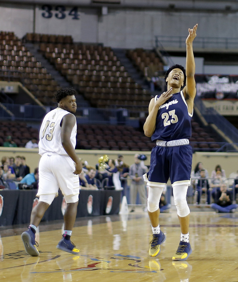 Photo - Heritage Hall's Trey Alexander  celebrates after a basket beside Broken Bow's Junior Crain during a Class 4A state tournament basketball game between Heritage Hall and Broken Bow High School in Jim Norick Arena at State Fair Park in Oklahoma City, Thursday, March 7, 2019. Photo by Bryan Terry, The Oklahoman