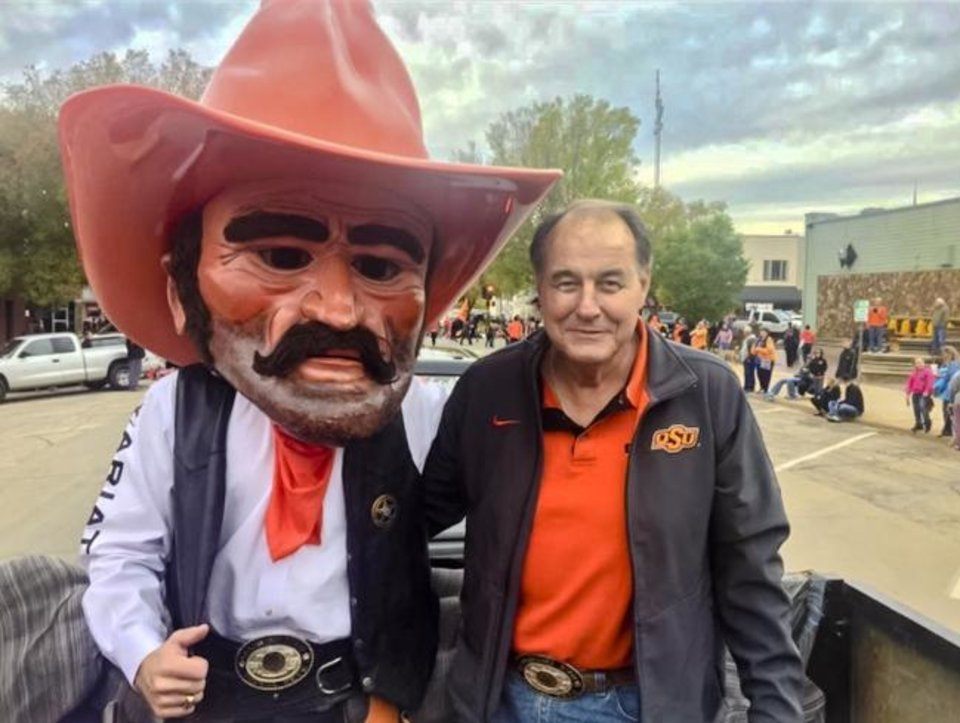 Photo -  Mark Whitlaw, right, poses with Pistol Pete. The man behind the mask is his son, Preston, who was Pete from 2014-16. [Photo Provided]