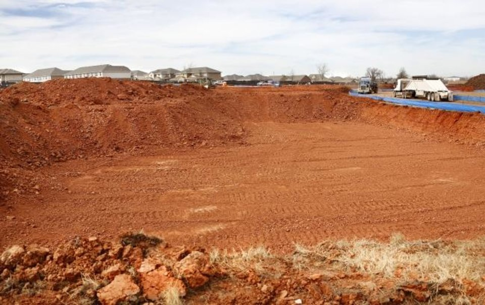 Photo -  Dirt work continues for The Curve Apartments in Moore. [JIM BECKEL/THE OKLAHOMAN]