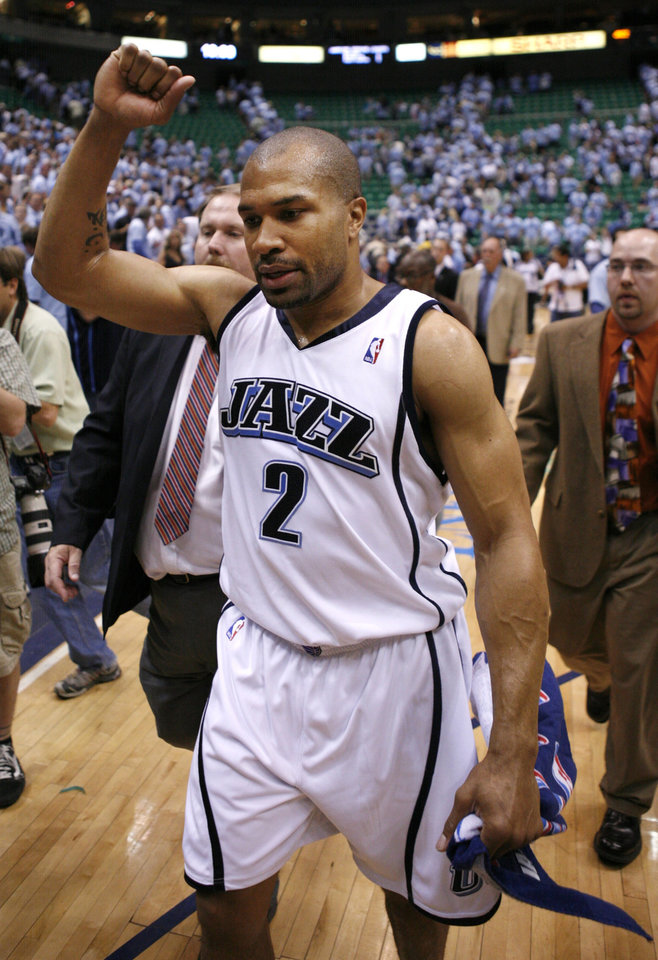 Photo - Utah Jazz's Derek Fisher walks off the court after a second-round playoff NBA basketball game against the Golden State Warriors, Wednesday, May 9, 2007, in Salt Lake City. The Jazz won 127-117 in overtime. (AP Photo/Steve C. Wilson)