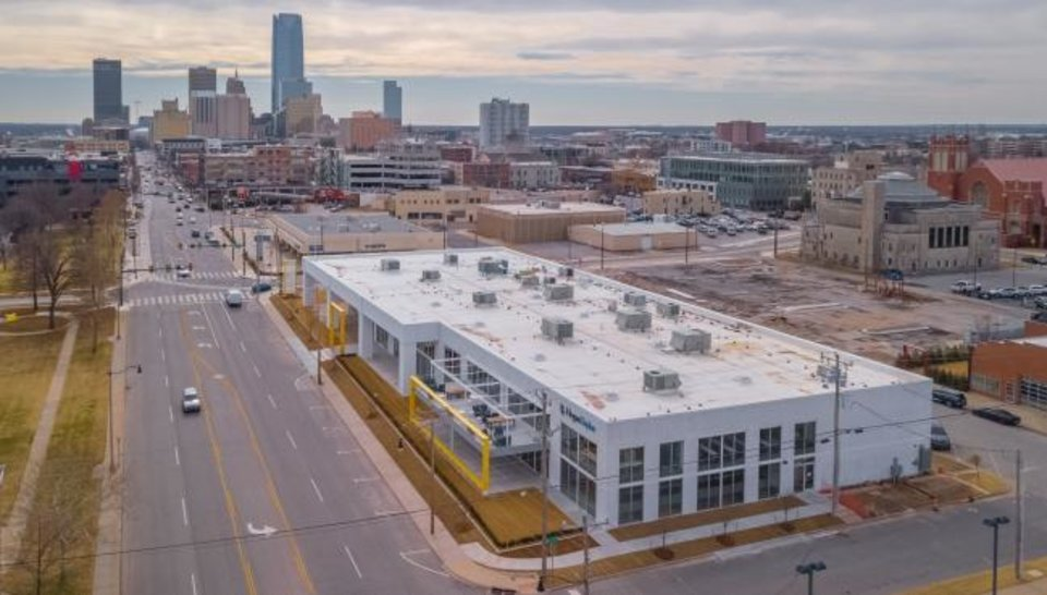 Photo -  Automobile Alley continues to evolve as the last dealerships leave the area. The empty dealership buildings are being redeveloped by Bob Howard, who has led in the revival of adjoining Midtown over the past decade. [DAVE MORRIS/The Oklahoman]