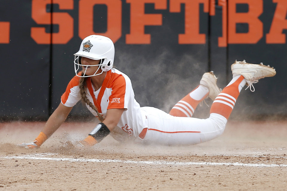 Photo -  Oklahoma State's Kiley Naomi scores a run in the fourth inning of Saturday's 2-1 victory over Tulsa in the Stillwater Regional. The Cowgirls were the first team Saturday to advance to the Super Regionals.  [Bryan Terry/The Oklahoman]
