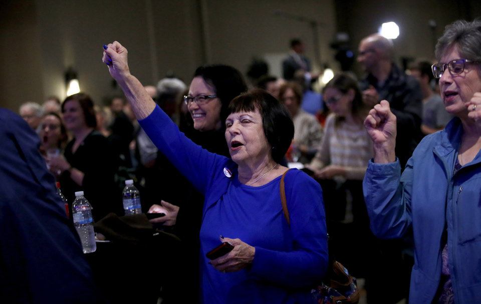 Photo - People cheer during a watch party for Drew Edmondson and the democratic party at the Embassy Suites  in Oklahoma City, Tuesday, Nov. 6, 2018. Photo by Sarah Phipps, The Oklahoman