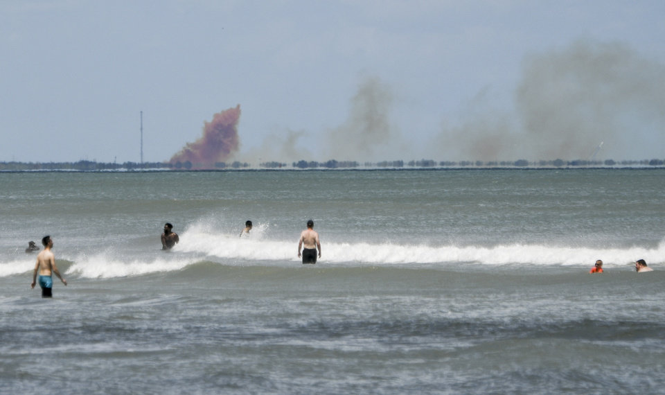 Photo -  FILE - In this Saturday, April 20, 2019 file photo, a cloud of smoke rises over nearby Cape Canaveral Air Force Station as seen from Cocoa Beach, Fla. SpaceX reported an anomaly during test firing of their Dragon 2 capsule at their LZ-1 landing site. (Craig Bailey/Florida Today via AP)