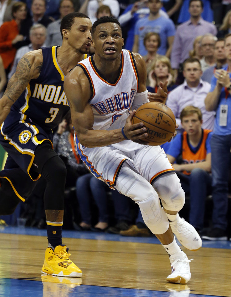 Photo - Oklahoma City Thunder's Russell Westbrook (0) drives around Indiana's George Hill (3) in the second half of an NBA basketball game where the Oklahoma City Thunder lost to the Indiana Pacers 101-98 at the Chesapeake Energy Arena in Oklahoma City, on Feb. 19, 2016.  Photo by Steve Sisney The Oklahoman