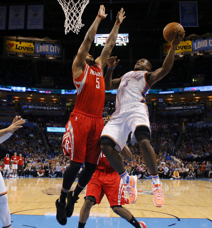 Photo - Oklahoma City's Dion Waiters (3) goes to the basket beside Houston's Josh Smith (5) during an NBA basketball game between the Oklahoma City Thunder and the Houston Rockets at Chesapeake Energy Arena in Oklahoma City, Friday, Jan. 29, 2016. Oklahoma City won 116-108. Photo by Bryan Terry, The Oklahoman