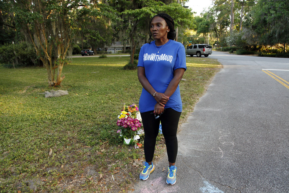 Photo -  In this May 17, 2020, photo, Wanda Cooper-Jones stands near the spot where her 25-year-old son Ahmaud Arbery was shot and killed while jogging through a Brunswick, Ga., neighborhood. She says her son ran every day to clear his mind. (AP Photo/Sarah Blake Morgan)