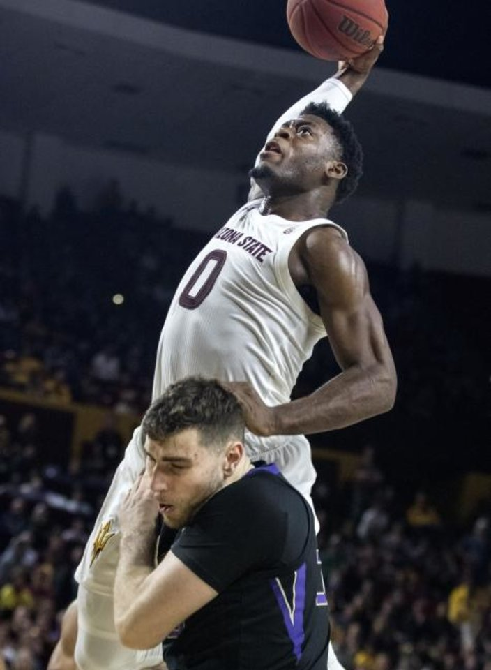 Photo -  Arizona State's Luguentz Dort (0) goes up and over Washington's Sam Timmins (33) during a Sun Devils win last February. [AP Photo/Darryl Webb]