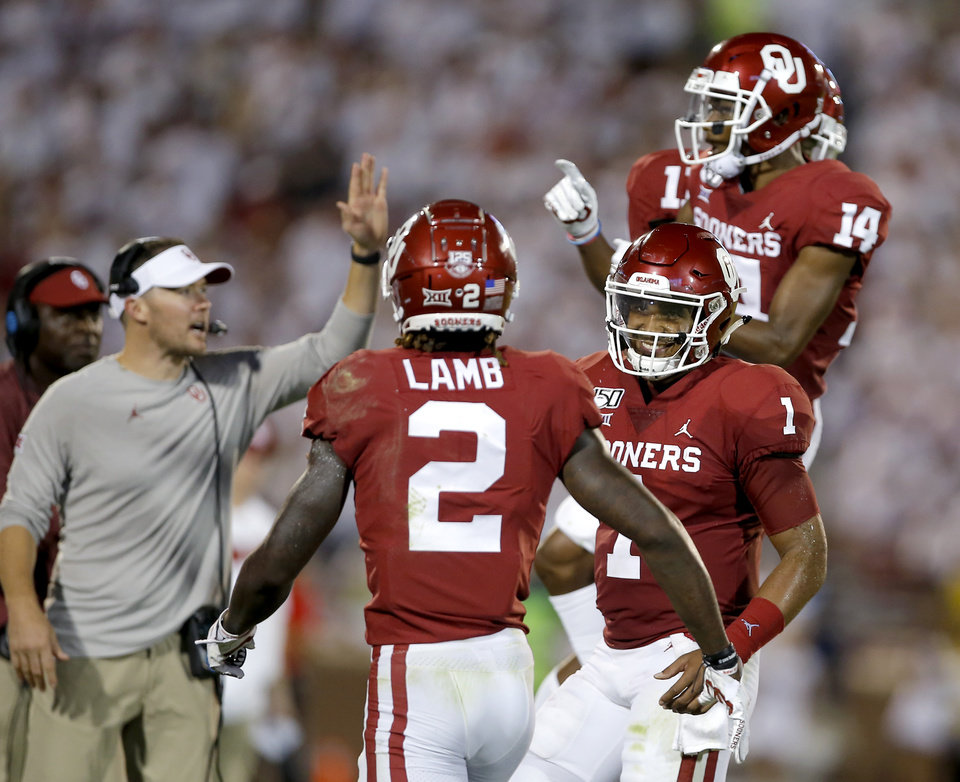 Photo - Oklahoma's Jalen Hurts (1) celebrates a  Charleston Rambo (14) touchdown with Oklahoma's CeeDee Lamb (2) in the third quarter during a college football game between the University of Oklahoma Sooners (OU) and the Houston Cougars at Gaylord Family-Oklahoma Memorial Stadium in Norman, Okla., Sunday, Sept. 1, 2019. [Sarah Phipps/The Oklahoman]