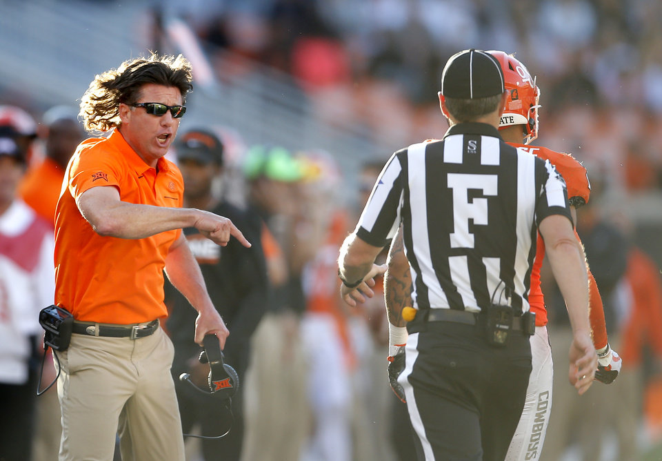Photo - Oklahoma State head coach Mike Gundy argues for a call in the third quarter during the college football game between Oklahoma State University and Baylor at Boone Pickens Stadium in Stillwater, Okla., Saturday, Oct. 19, 2019. Baylor won 45-27. [Sarah Phipps/The Oklahoman]