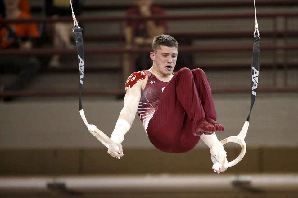Photo - Oklahoma's Jake Maloley competes on the rings during a gymnastics meet with Illinois at McCasland Field House. [PHOTO BY BRYAN TERRY, THE OKLAHOMAN]