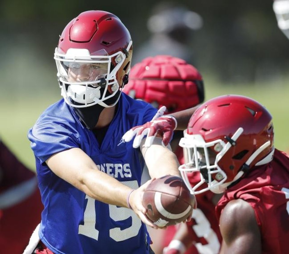 Photo -  Quarterback Tanner Mordecai (15) sports a black face mask during a recent practice. [Ty Russell/SoonerSports.com]