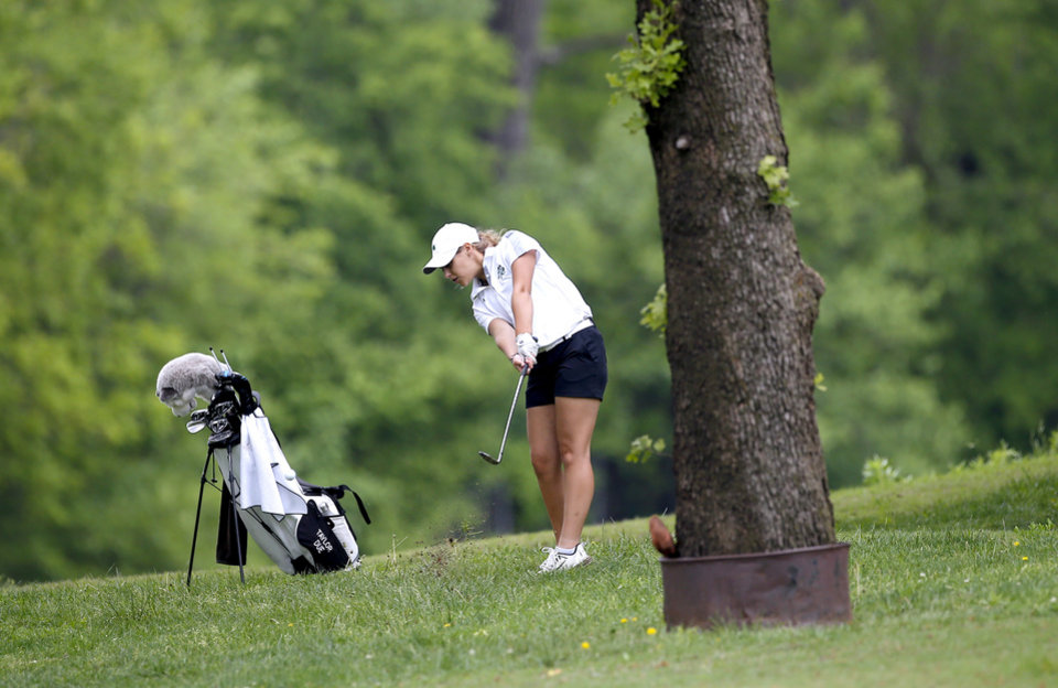 Photo - McGuinness' Taylor Due hits on 16th hole during the 5A girls golf state tournament at Lincoln Park West in Oklahoma City, Wednesday, May 1, 2019. [Sarah Phipps/The Oklahoman]