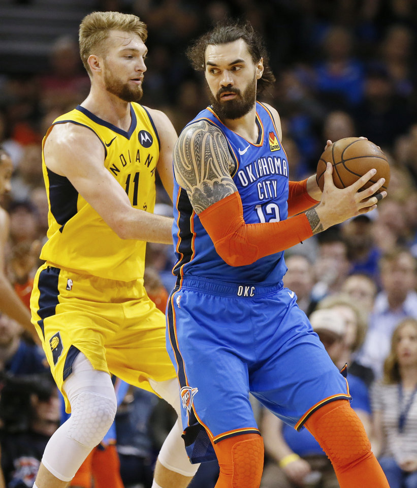 Photo - Oklahoma City's Steven Adams (12) looks to move around Indiana's Domantas Sabonis (11) in the fourth quarter during an NBA basketball game between the Indiana Pacers and the Oklahoma City Thunder at Chesapeake Energy Arena in Oklahoma City, Wednesday, March 27, 2019. Oklahoma City won 107-99. Photo by Nate Billings, The Oklahoman