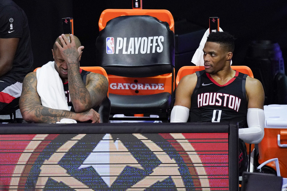 Photo - Houston Rockets' P.J. Tucker, left, and Russell Westbrook sit on the bench in the closing minutes of a loss to the Los Angeles Lakers during the second half of an NBA conference semifinal playoff basketball game Saturday, Sept. 12, 2020, in Lake Buena Vista, Fla. (AP Photo/Mark J. Terrill)