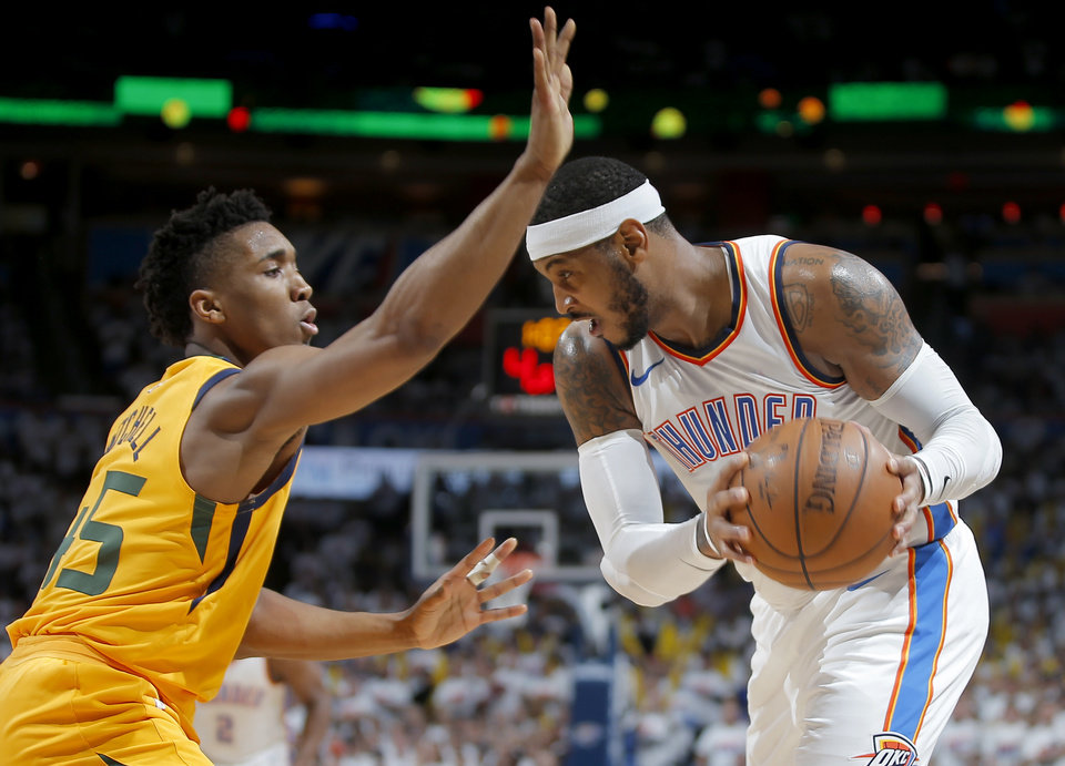 Photo -  Oklahoma City's Carmelo Anthony tries to get past Utah's Donovan Mitchell during Game 2 at Chesapeake Energy Arena on April 18. Utah won 102-95. [Photo by Bryan Terry, The Oklahoman]