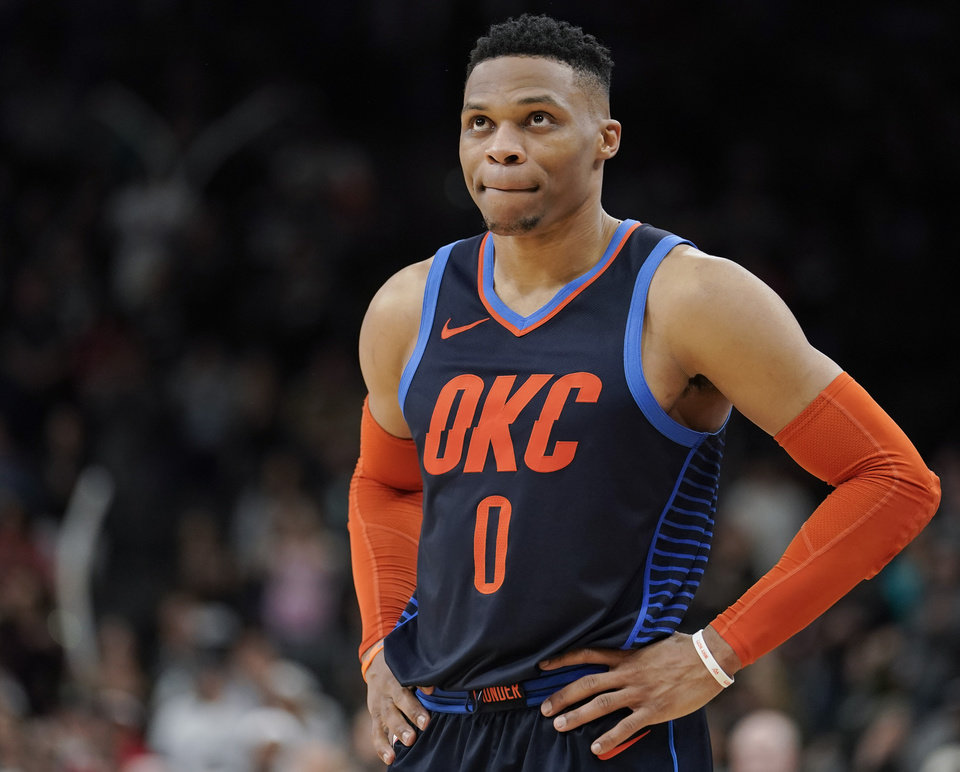 Photo -  Russell Westbrook had a career-high 24 assists Thursday in the Thunder's 154-147 double-overtime loss to the Spurs. [AP PHOTO]
