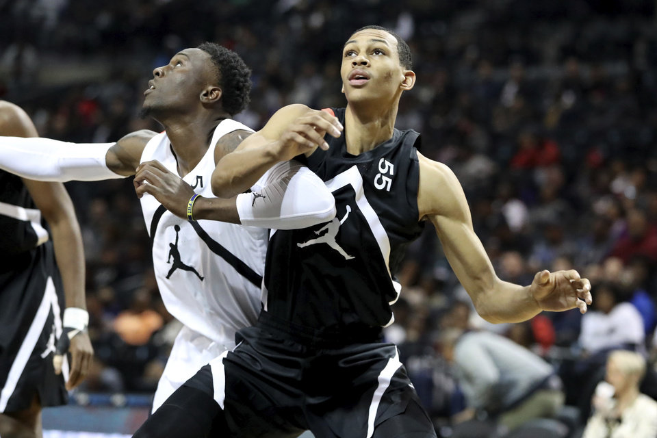 Photo - The Black Team's Darius Bazley #55 in action against the White Team during the Jordan Brand Classic high school basketball game, Sunday, April 8, 2018, in Brooklyn. (AP Photo/Gregory Payan)