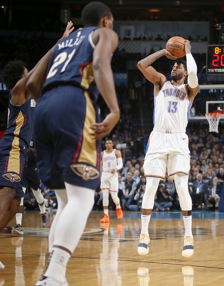 Photo - Oklahoma City's Paul George (13) takes a shot during an NBA basketball game between the Oklahoma City Thunder and the New Orleans Pelicans at Chesapeake Energy Arena in Oklahoma City, Thursday, Jan. 24, 2019. Photo by Bryan Terry, The Oklahoman
