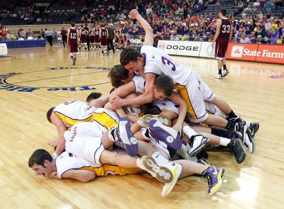 Photo -  Red Oak celebrates their win over Garber in the Class B State Basketball finals, Saturday, March 7, 2009, at the State Fair Arena in Oklahoma City . PHOTO BY SARAH PHIPPS, THE OKLAHOMAN