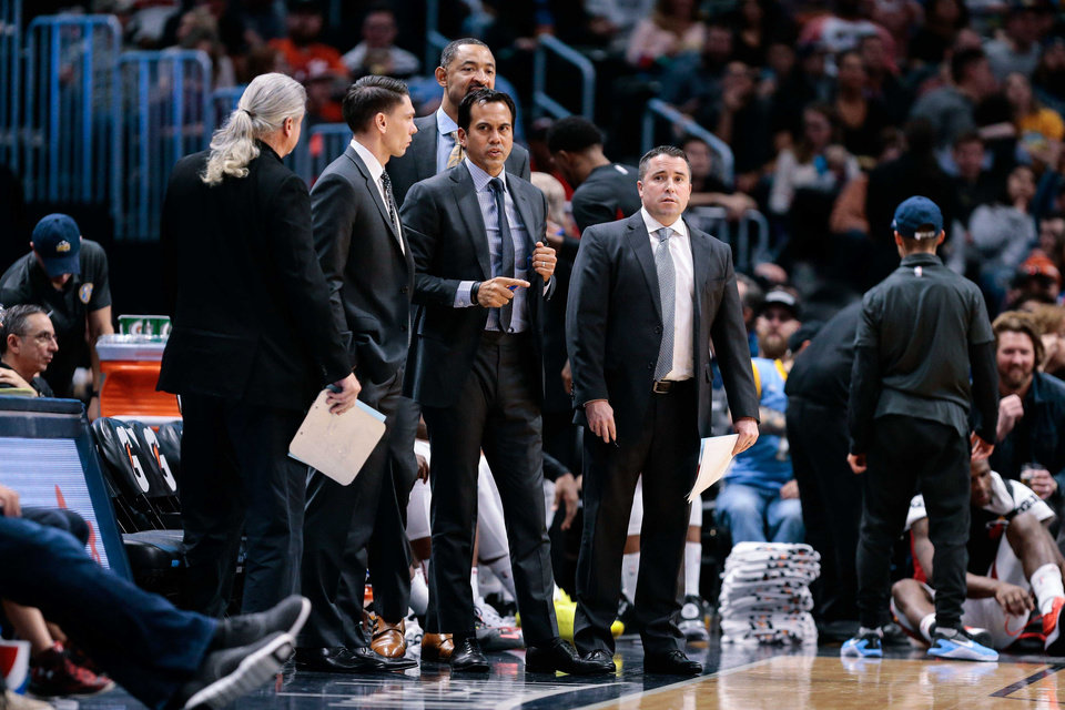 Photo -  Miami Heat head coach Erik Spoelstra (center) with assistant coaches Chris Quinn (left) and Dan Craig (right) and Juwan Howard (behind) during a game in Denver. [Isaiah J. Downing/USA TODAY Sports]