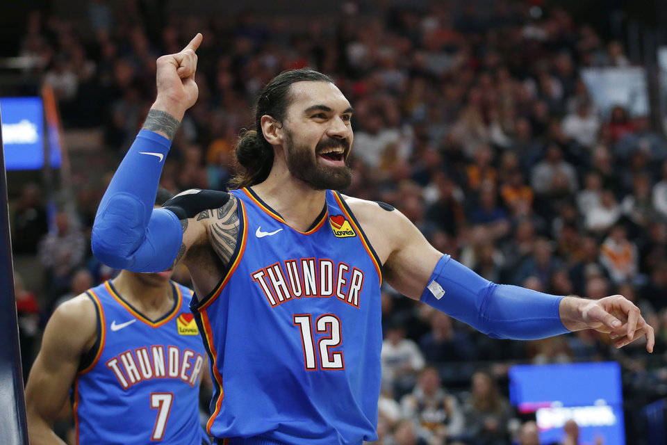 Photo - Oklahoma City Thunder center Steven Adams (12) reacts after being fouled by Utah Jazz center Rudy Gobert in the second half during an NBA basketball game Monday, Dec. 9, 2019, in Salt Lake City. (AP Photo/Rick Bowmer)
