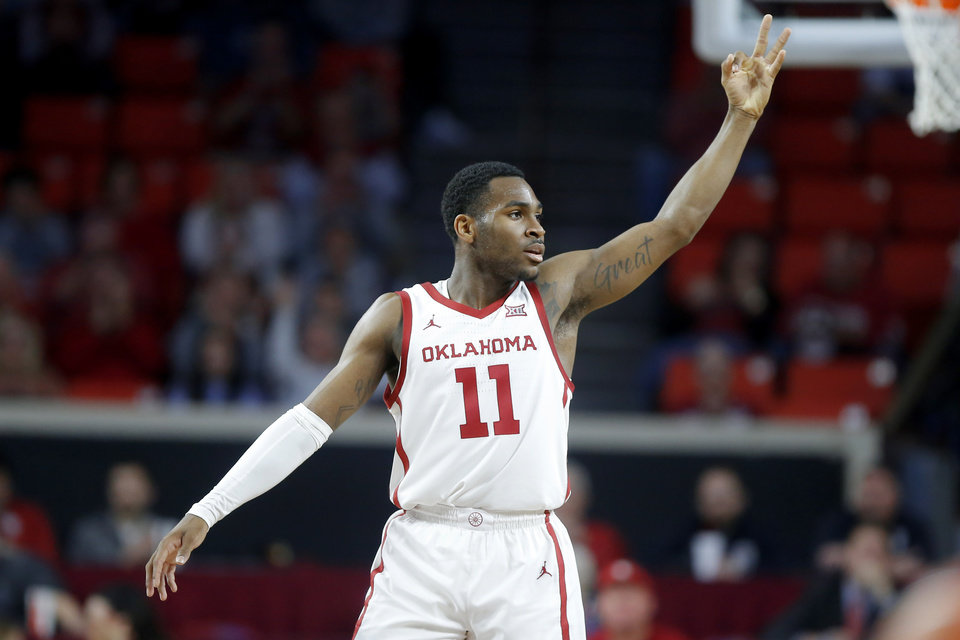 Photo - Oklahoma's De'Vion Harmon (11) celebrates after an Oklahoma basket during an NCAA mens college basketball game between the University of Oklahoma Sooners (OU) and the West Virginia Mountaineers at the Lloyd Noble Center in Norman, Okla.,Saturday, Feb. 8, 2020. Oklahoma won 69-59. [Bryan Terry/The Oklahoman]