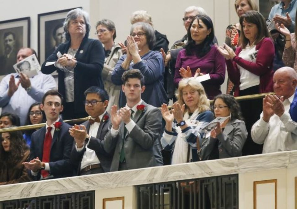 Photo -  People in the gallery of the House of Representatives chamber applaud during Rose Day at the state Capitol. [Nate Billings/The Oklahoman]