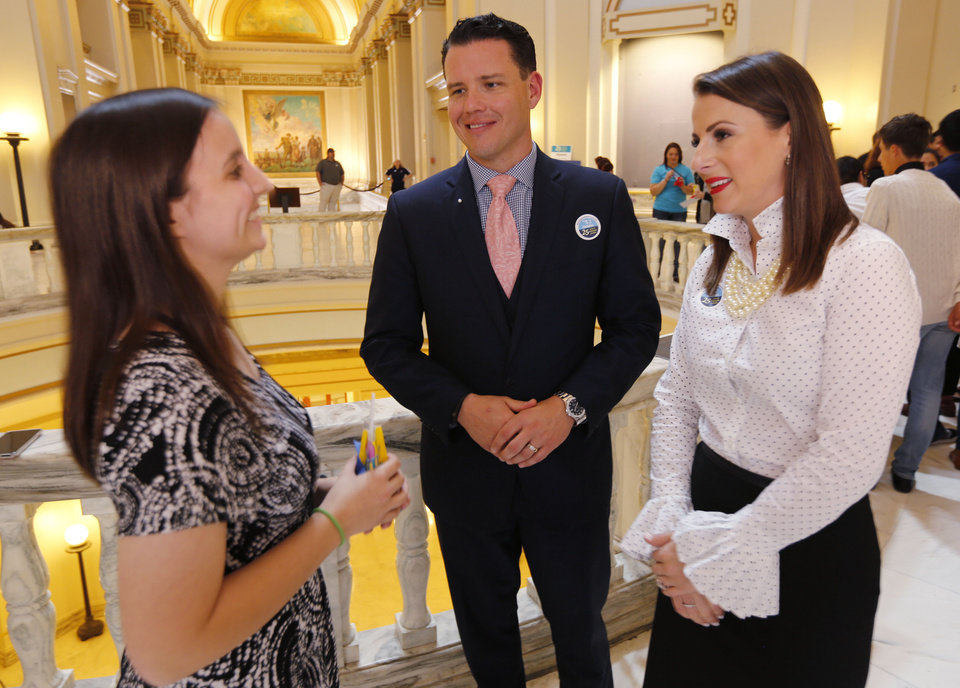 Photo -  Katie Carroll, left, of Tishomingo, talks with Sen. Jason Smalley and Rep. Katie Henke during an event in support of the Oklahoma's Promise Scholarship program Tuesday at the state Capitol. [Photo by Paul Hellstern, The Oklahoman]