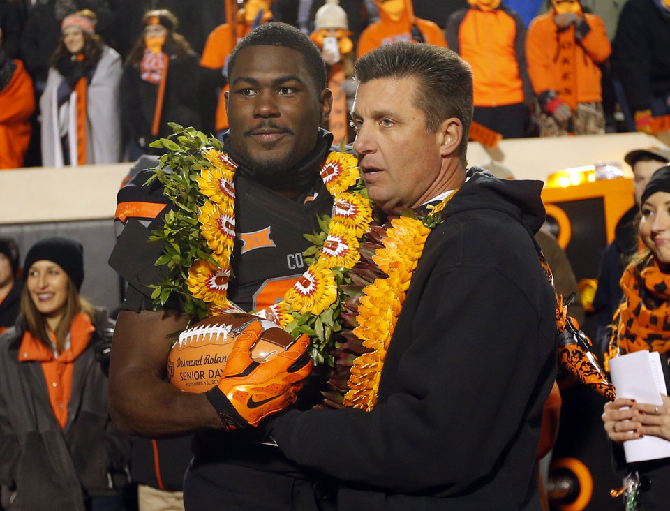Photo - Oklahoma State's Desmond Roland (26) takes a picture with head coach Mike Gundy before the college football game between the Oklahoma State University Cowboys (OSU) the University of Texas Longhorns (UT) at Boone Pickens Staduim in Stillwater, Okla. on Saturday, Nov. 15, 2014.  Photo by Sarah Phipps, The Oklahoman