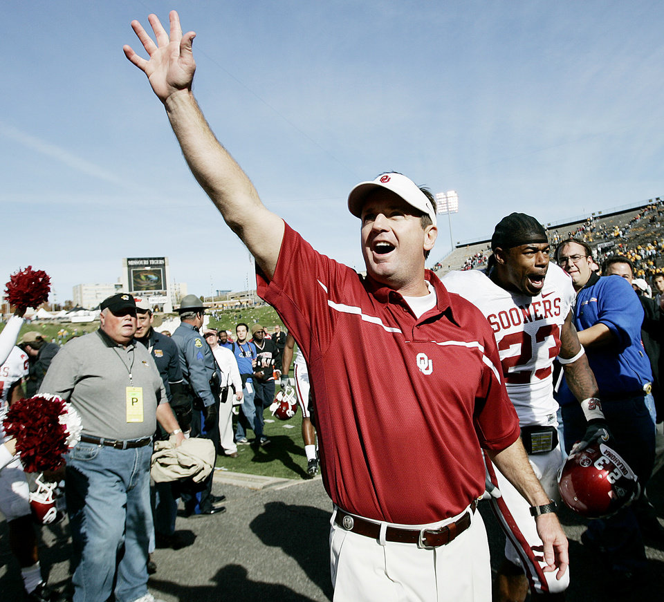 Photo - CELEBRATE, CELEBRATION: University of Oklahoma head coach Bob Stoops along with Allen Patrick celebrate after OU's 26-10 win over the University of Missouri (MU) at Faurot Field/Memorial Stadium on Saturday, Oct. 28, 2006, in Columbia, Mo.  By Bryan Terry, The Oklahoman  ORG XMIT: KOD