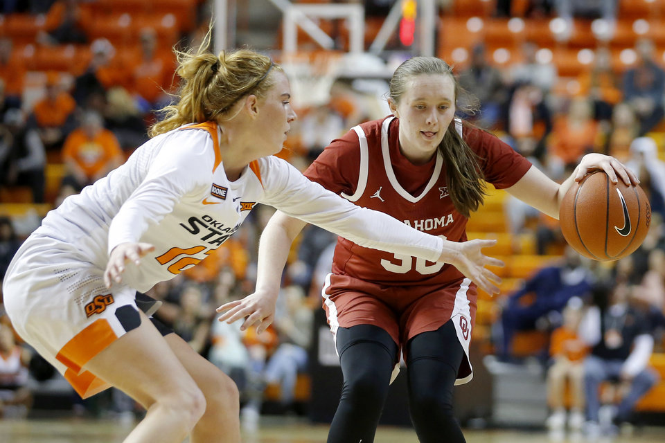 Photo - Oklahoma's Taylor Robertson (30) tries to go past Oklahoma State's Vivian Gray (12) during a women's Bedlam college basketball game between the Oklahoma State University Cowgirls (OSU) and the University of Oklahoma Sooners (OU) at Gallagher-Iba Arena in Stillwater, Okla., Wednesday, Jan. 8, 2020. [Bryan Terry/The Oklahoman]