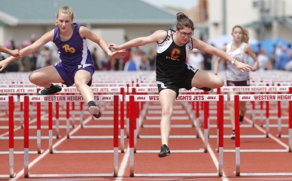 Photo -  Carney's Haley Newlun, right, and Red Oak's Brooke Baldwin compete in the Class A girls 100-meter hurdles Saturday during the Class A and 2A state track meet. [Sarah Phipps/The Oklahoman]