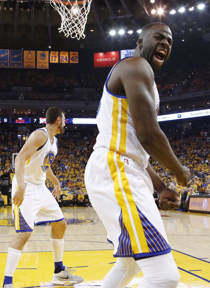 Photo - Golden State's Draymond Green (23) reacts after blocking a shot by Oklahoma City's Russell Westbrook (not pictured) near Andrew Bogut (12) during Game 5 of the Western Conference finals in the NBA playoffs between the Oklahoma City Thunder and the Golden State Warriors at Oracle Arena in Oakland, Calif., Thursday, May 26, 2016. The Warriors won 120-111. Photo by Nate Billings, The Oklahoman