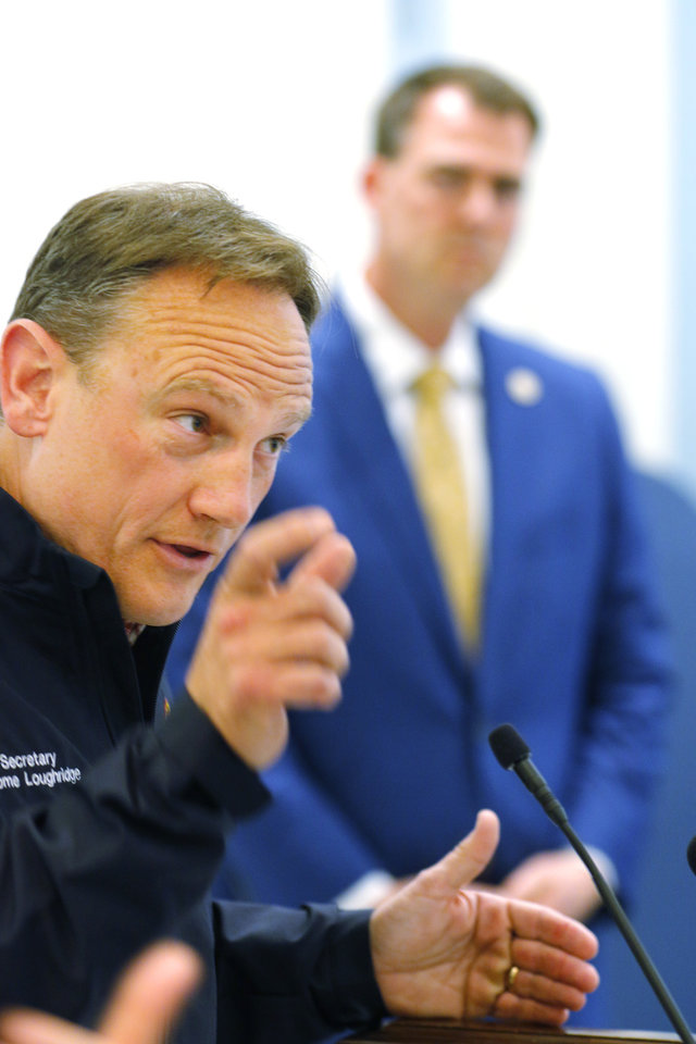 Photo - Jerome Loughridge addresses the the media during a briefing for the Governor's Solution Task Force to provide an update on Oklahoma's COVID-19 response in the Blue Room of the Capitol Wednesday, April 15, 2020.  [Photo by Doug Hoke/The Oklahoman]