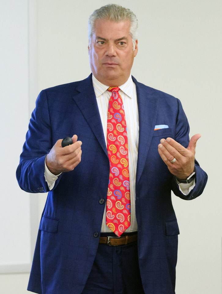 Photo -  Attorney Vic Albert speaks during a seminar at Rose State College for businesses as they adjust their policies to adapt to the passing of medical marijuana laws.