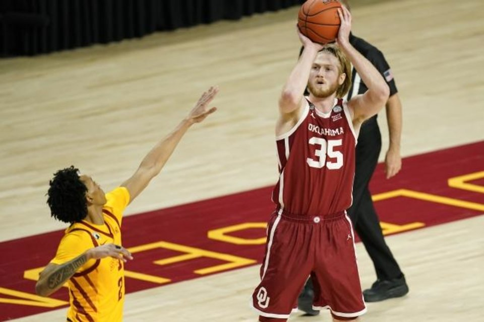 Photo -  Oklahoma forward Brady Manek (35) shoots during the first half of a 66-56 win at Iowa State on Saturday. [AP Photo/Charlie Neibergall]