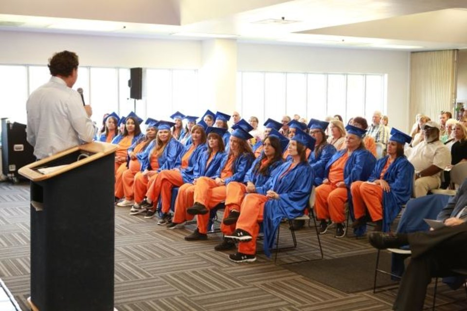 Photo -  Oklahoma County District Court Judge Ken Stoner gives the commencement address at a Prison Fellowship Academy graduation at Kate Barnard Correctional Center. [Charles Prince/Prison Fellowship]