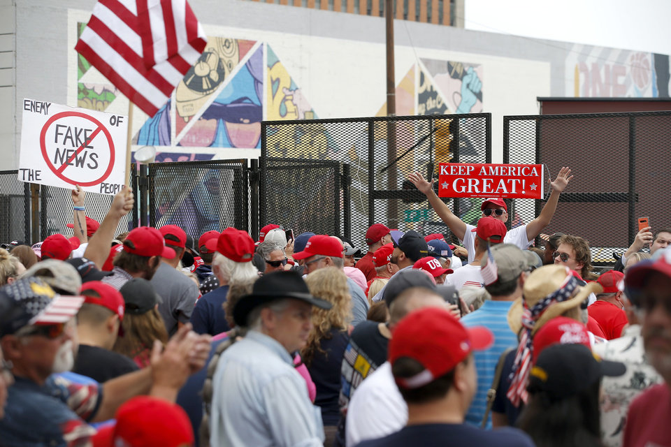 Photo - President Donald Trump supporters outside a security gate before a rally at the BOK Center in Tulsa, Okla., Saturday, June 20, 2020. [Bryan Terry/The Oklahoman]